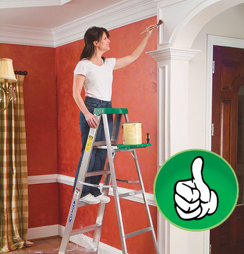 Woman Painting Using 3-Point Ladder Safety